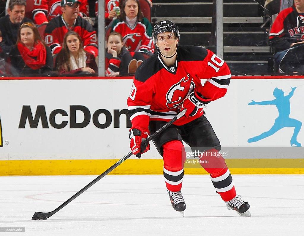 Peter Harrold of the New Jersey Devils plays the puck against the Washington Capitals during the game at the Prudential Center on April 4 2014 in...