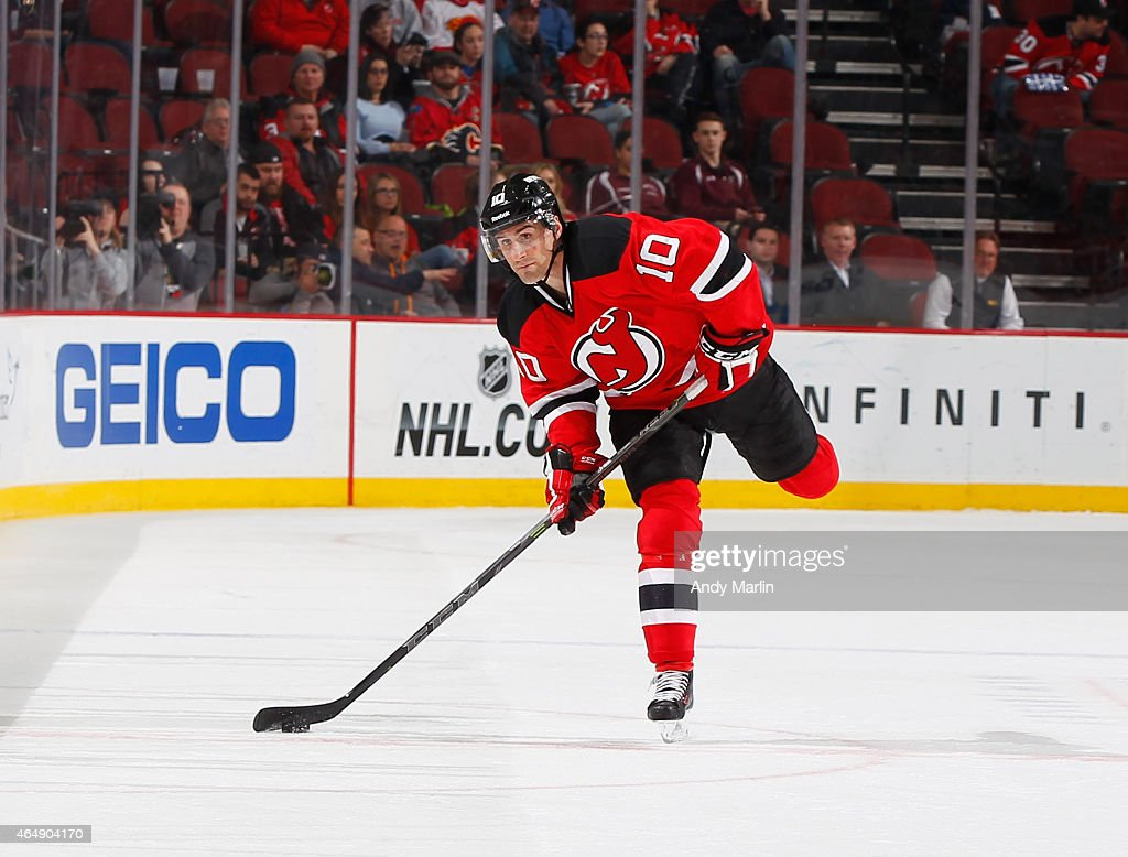 Peter Harrold of the New Jersey Devils plays the puck during the game against the Calgary Flames at the Prudential Center on February 25 2015 in...