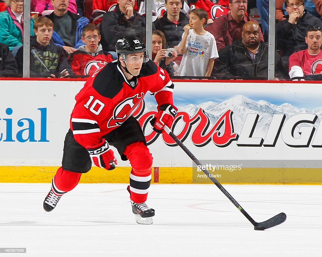 Peter Harrold of the New Jersey Devils plays the puck during the game against the Florida Panthers at the Prudential Center on March 31 2014 in...