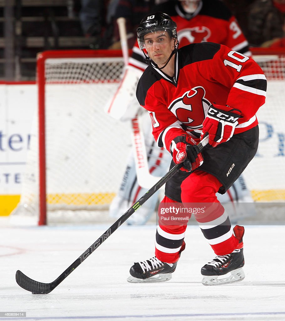 Peter Harrold of the New Jersey Devils skates in an NHL hockey game against the Carolina Hurricanes at Prudential Center on December 23 2014 in...