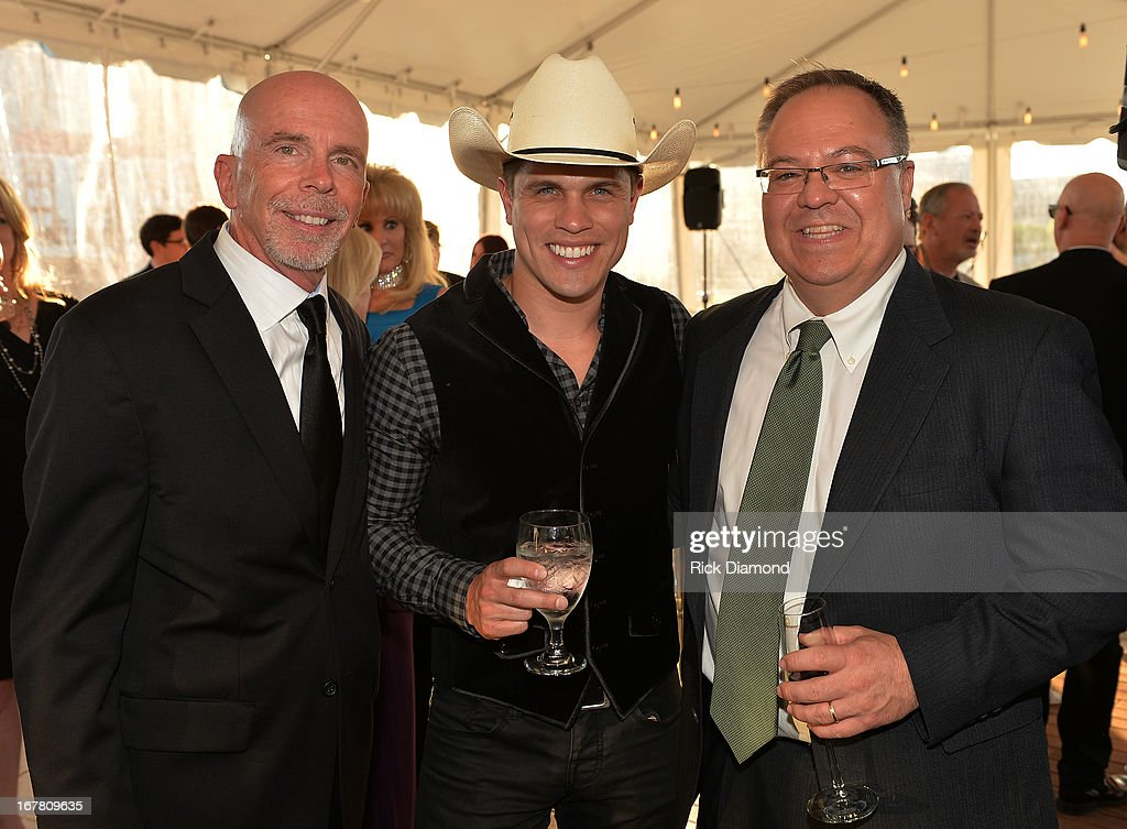 Peter Hartung (Broken Bow), Recording Artist Dustin Lynch and Derek Crownover attend the 14th annual T.J. Martell Foundation Nashville Best Cellars dinner at the Bridge Building on April 29, 2013 in Nashville, Tennessee.