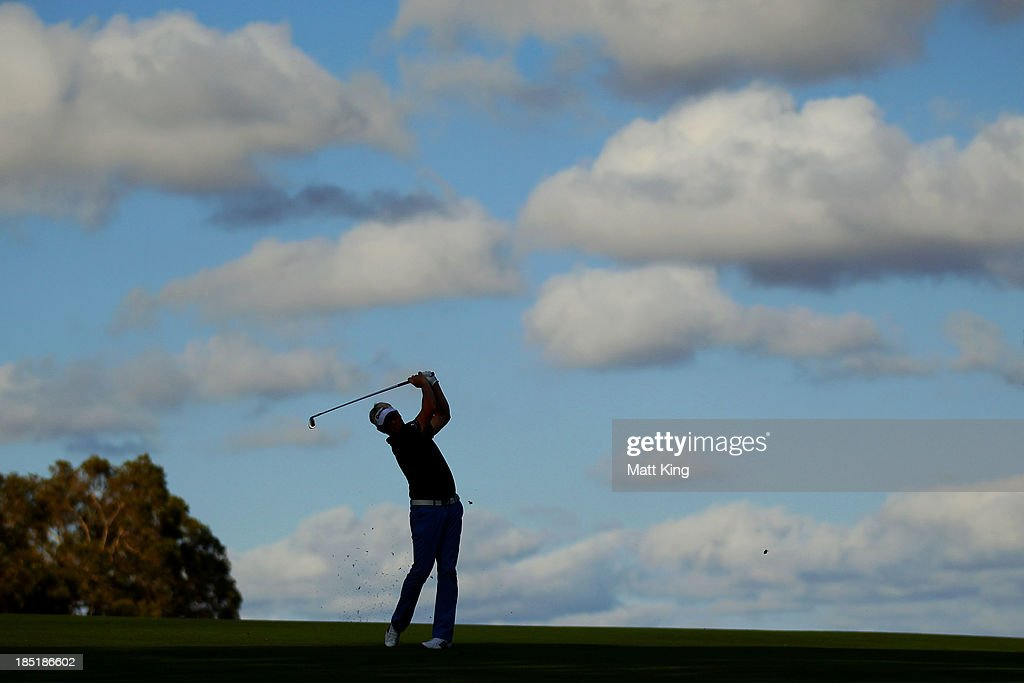 <a gi-track='captionPersonalityLinkClicked' href=/galleries/search?phrase=Peter+Hedblom&family=editorial&specificpeople=211513 ng-click='$event.stopPropagation()'>Peter Hedblom</a> of Sweden plays his approach shot on the 18th hole during day two of the Perth International at Lake Karrinyup Country Club on October 18, 2013 in Perth, Australia.