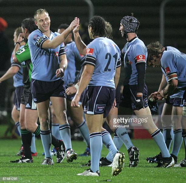 Peter Hewat celebrates with his Waratahs team mates following the round twelve Super 14 rugby match between the Highlanders and the Waratahs at...