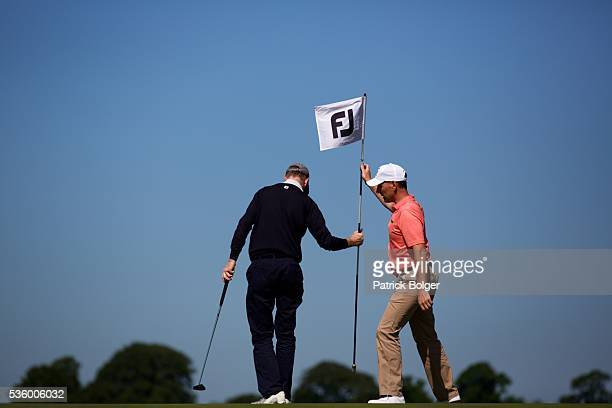 Peter Hickey and David Higgins replace the flag on the 10th green at Carton House Golf Club on May 31 2016 in Maynooth Ireland
