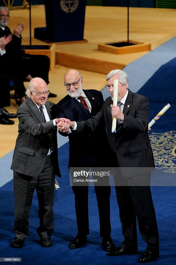 Peter Higgs, Francois Englert and Rolf Heuer receive the Prince of Asturias Award for Technical & Scientific Research during the 'Prince of Asturias Awards 2013' ceremony at the Campoamor Theater on October 25, 2013 in Oviedo, Spain.