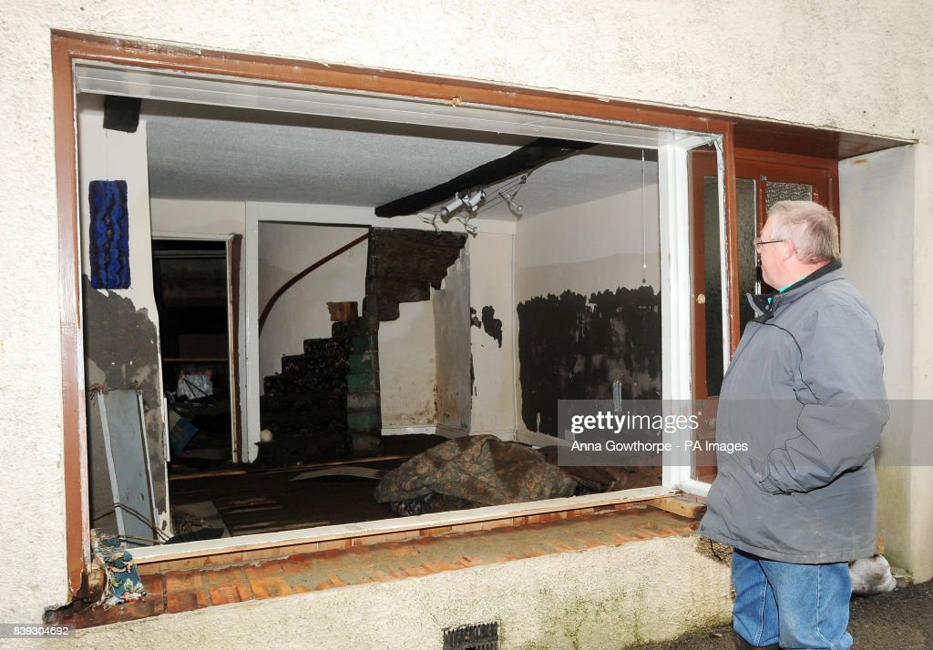 Peter Hirst Looks Through The Empty Window Frame Into His Living Room In Cockermouth To See