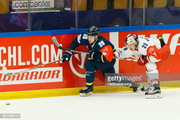 Peter Hochkofler of Red Bull Salzburg chases Ian Ornskog of HV71 and the puck during the Champions Hockey League match between HV71 Jonkoping and Red...