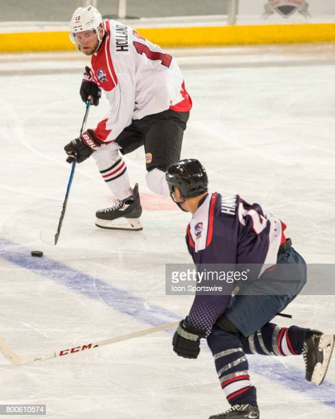Peter Holland of Team Canada looks for options past Scott Hannnan of Team USA during the Melbourne Game of the Ice Hockey Classic on June 24 2017...