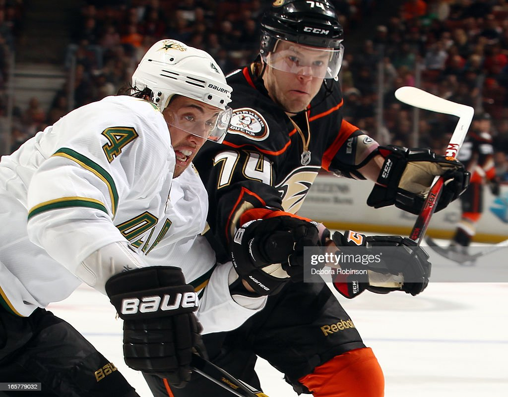 Peter Holland #74 of the Anaheim Ducks battles for position against <a gi-track='captionPersonalityLinkClicked' href=/galleries/search?phrase=Brenden+Dillon&family=editorial&specificpeople=6254216 ng-click='$event.stopPropagation()'>Brenden Dillon</a> #4 of the Dallas Stars on April 5, 2013 at Honda Center in Anaheim, California.