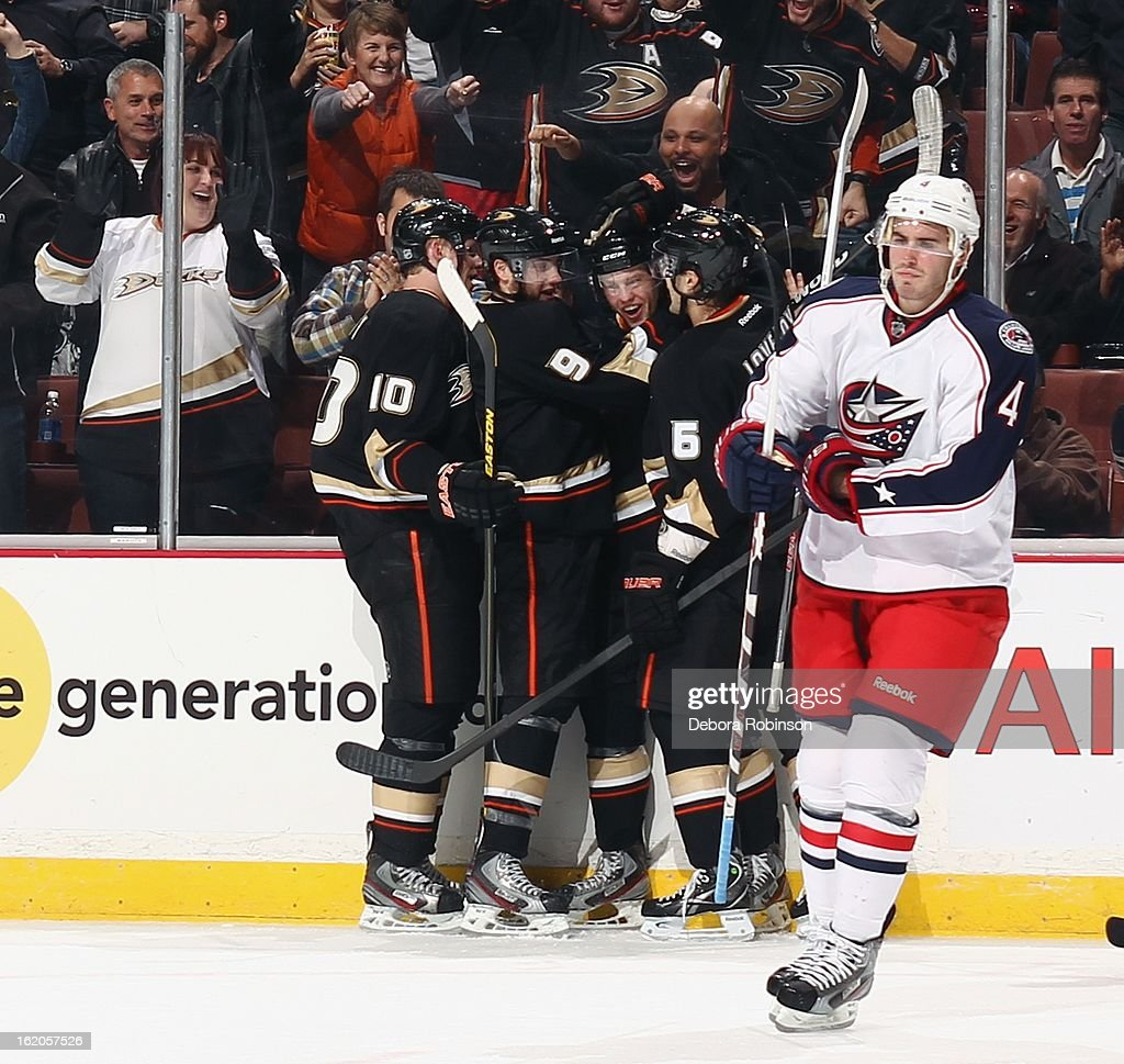 Peter Holland #74 of the Anaheim Ducks celebrates with teammates Corey Perry #10,Bobby Ryan #9 and Ben Lovejoy #6 after scoring a goal against the Columbus Blue Jackets on February 18, 2013 at Honda Center in Anaheim, California.