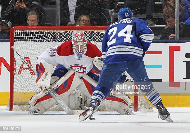 Peter Holland of the Toronto Maple Leafs moves in to beat Mike Condon of the Montreal Canadiens in the shootout during an NHL game at the Air Canada...