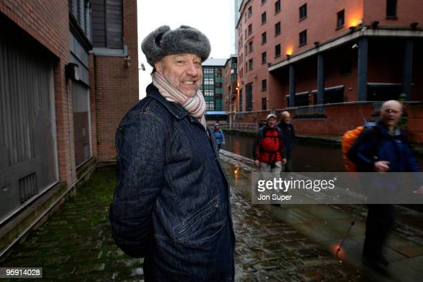 Peter Hook bass player with New Order and previously Joy Division poses for a portrait session next to the Hacienda Apartments formerly the Hacienda...