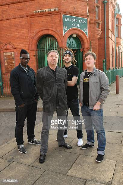 Peter Hook poses young people from Salford as they met with Manchester United star Owen Hargreaves and local band Kid British on Tuesday as music and...