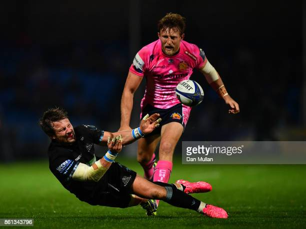Peter Horne of Glasgow Warriors offloads under pressure from Lachie Turner of Exeter Chiefs during the European Rugby Champions Cup Pool 3 match...