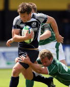 Peter Horne of Scotland breaks through a tackle during the IRB Junior World Championships game between Ireland and Scotland on June 22 2008 at Rodney...