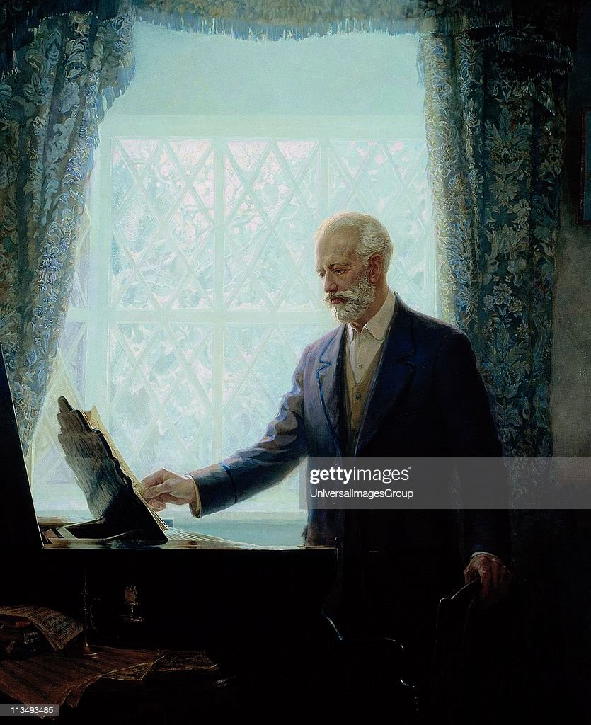 Peter Ilich Tchaikovsky (1840-1893), Russian composer. Portrait of Tchaikovsky standing by a piano looking at a score on the music stand. Music Romantic Musician.
