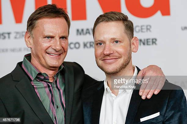 Peter Illmann and Marco Kreuzpaintner attend the 'Coming In' Premiere in Berlin on October 22 2014 in Berlin Germany