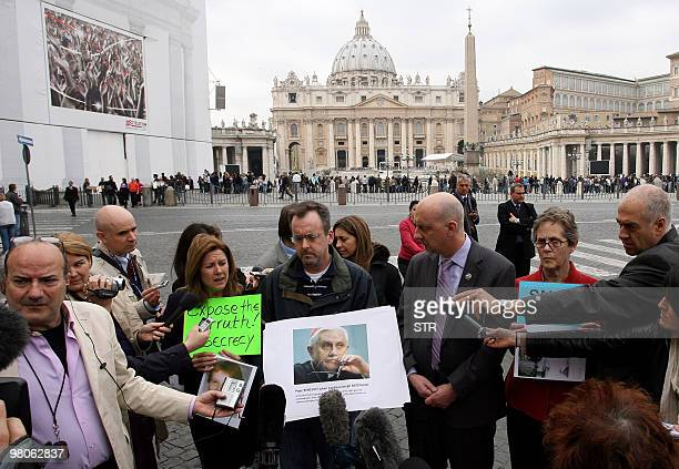 Peter Isely John Pilmaier and Barbara Blaine all of the US organisation SNAP hold up a picture of Pope benedict XVI on March 25 2010 as they take...