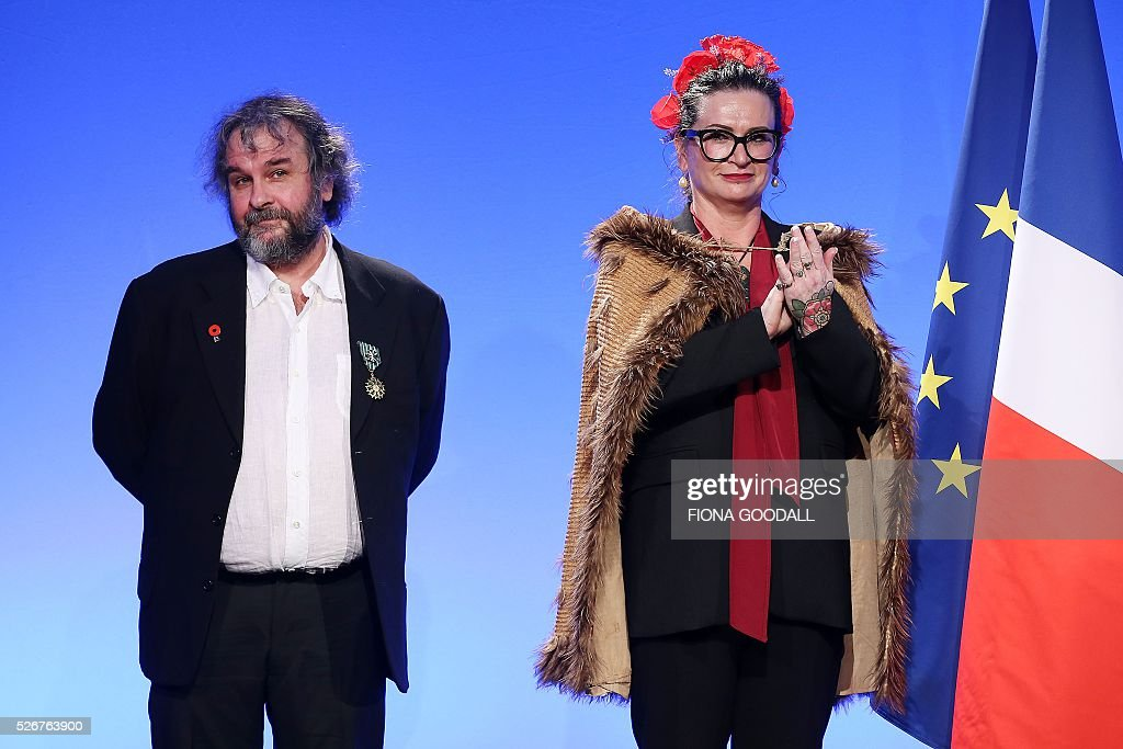 Peter Jackson (L) and Fiona Pardington (R) listen as French Prime Minister Manuel Valls presents them with a Ordre des Arts et des Lettres medal at a French community event at Auckland War Memorial Museum on May 1, 2016. / AFP / Fiona Goodall