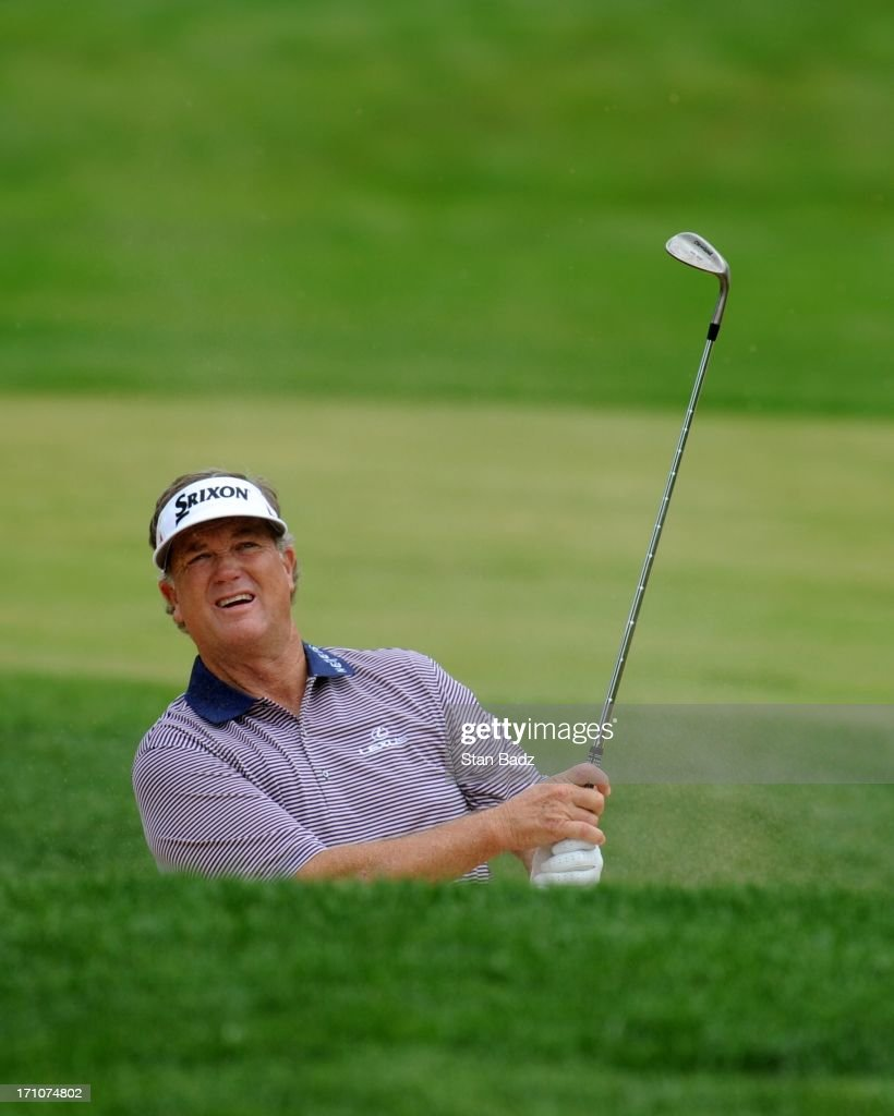 Peter Jacobsen watches his bunker shot on the ninth hole during the first round of the Encompass Championship at North Shore Country Club on June 21, 2013 in Glenview, Illinois.