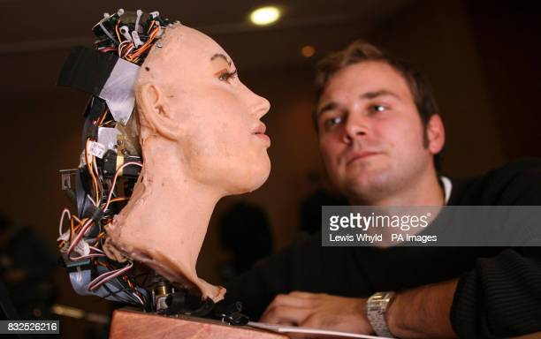 Peter Joeckel a PHD student from the University of the West of England looks at Eva an animatronic robot head that he has programmed to recognise the...