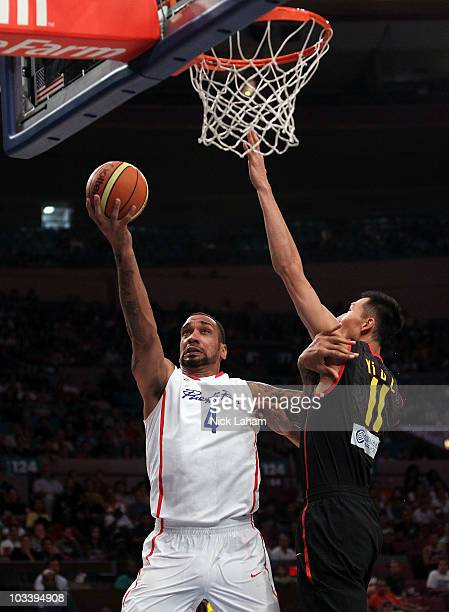 Peter John Ramos of Puerto Rico lays the ball up against Yi Jianlian of China during their exhibition game as part of the World Basketball Festival...