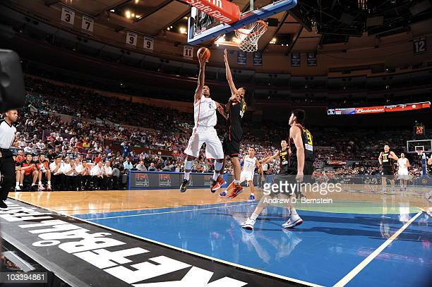 Peter John Ramos of Puerto Rico shoots against Yi Jianlian of China on August 15 2010 at Madison Square Garden in New York City NOTE TO USER User...
