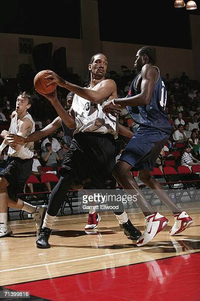 Peter John Ramos of the Washington Wizards plays the ball against Cheikh Samb of the Detroit Pistons during the 2006 Toshiba Vegas Summer League on...