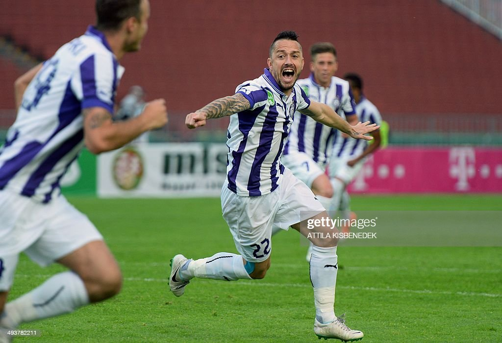 Peter Kabat (C) of TE Ujpest celebrates scoring during the Hungarian Cup final football match VTK Disosgyor vs TE Ujpest on May 25, 2014 at the Puskas stadium in Budapest.