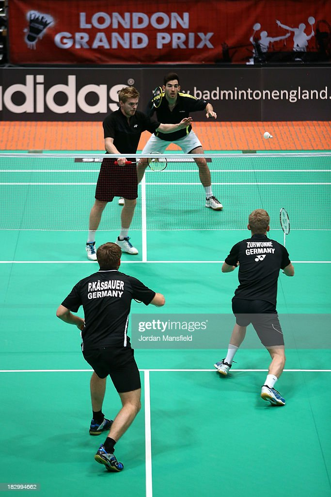 Peter Kaesbauer and Josche Zurwonne of Germany (below) in action in their mens doubles match against Marcus Ellis of England and Paul van Rietvelde of Scotland (above) during Day 3 of the London Badminton Grand Prix at The Copper Box on October 3, 2013 in London, England.
