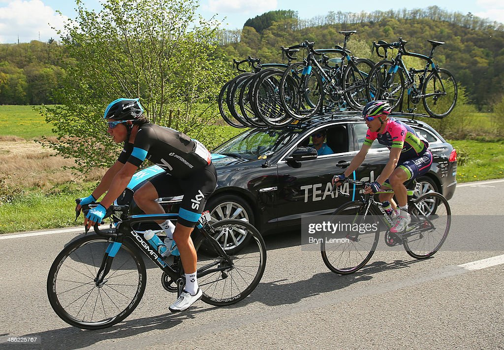 <a gi-track='captionPersonalityLinkClicked' href=/galleries/search?phrase=Peter+Kennaugh&family=editorial&specificpeople=5542463 ng-click='$event.stopPropagation()'>Peter Kennaugh</a> of Great Britain and Team SKY (L) and <a gi-track='captionPersonalityLinkClicked' href=/galleries/search?phrase=Damiano+Cunego&family=editorial&specificpeople=546982 ng-click='$event.stopPropagation()'>Damiano Cunego</a> of Italy and Team Lampre-Merida in action during the 78th edition of the La Fleche Wallonne on April 23, 2014 in Bastogne, Belgium. The 199km parcours scales the Mur de Huy climb three times, with the final 9.3% average ascent providing the finish to the race.