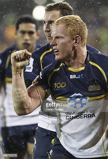 Peter Kimlin of the Brumbies celebrates after scoring a try during the round 16 Super Rugby match between the Brumbies and the Hurricanes at Canberra...