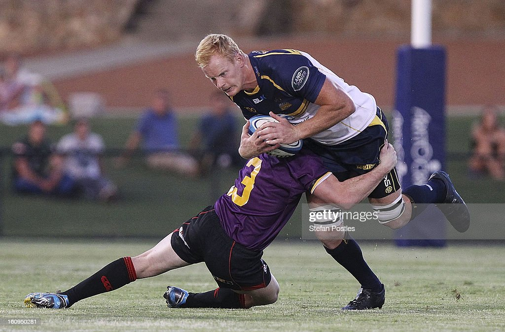 <a gi-track='captionPersonalityLinkClicked' href=/galleries/search?phrase=Peter+Kimlin&family=editorial&specificpeople=2247621 ng-click='$event.stopPropagation()'>Peter Kimlin</a> of the Brumbies is tackled by Matt Hawk of the ACT XV during the Super Rugby trial match between the Brumbies and the ACT XV at Viking Park on February 8, 2013 in Canberra, Australia.