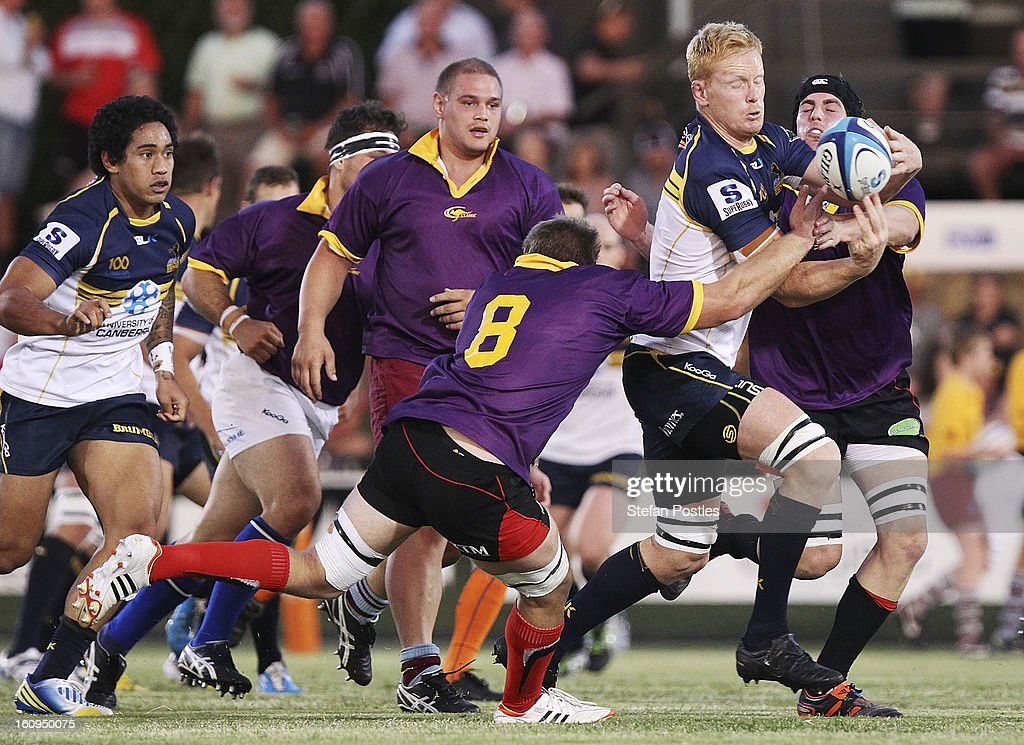 <a gi-track='captionPersonalityLinkClicked' href=/galleries/search?phrase=Peter+Kimlin&family=editorial&specificpeople=2247621 ng-click='$event.stopPropagation()'>Peter Kimlin</a> of the Brumbies is tackled by Tim Cree of the ACT XV during the Super Rugby trial match between the Brumbies and the ACT XV at Viking Park on February 8, 2013 in Canberra, Australia.