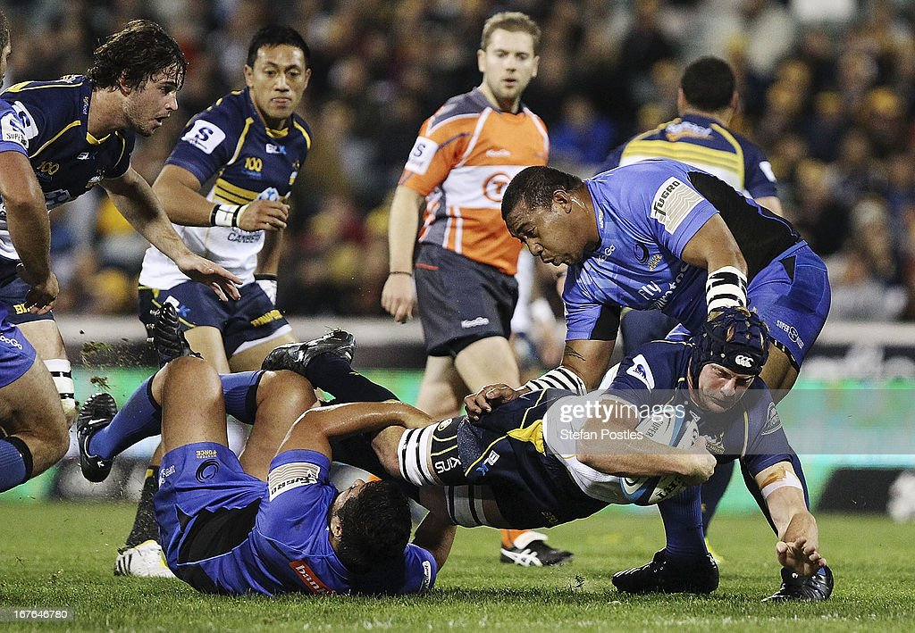 <a gi-track='captionPersonalityLinkClicked' href=/galleries/search?phrase=Peter+Kimlin&family=editorial&specificpeople=2247621 ng-click='$event.stopPropagation()'>Peter Kimlin</a> of the Brumbies is tackled during the round 11 Super Rugby match between the Brumbies and the Force at Canberra Stadium on April 27, 2013 in Canberra, Australia.