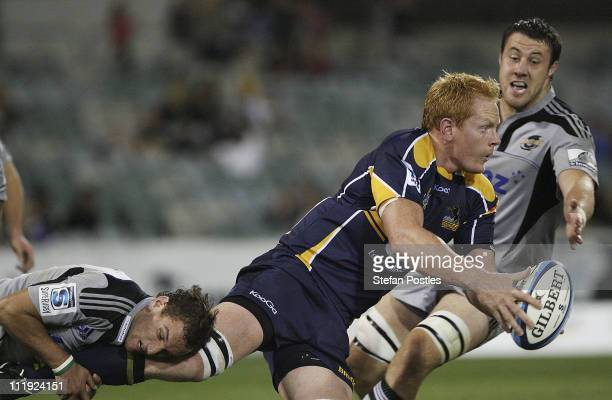 Peter Kimlin of the Brumbies is tackled during the round eight Super Rugby match between the Brumbies and the Hurricanes at Canberra Stadium on April...