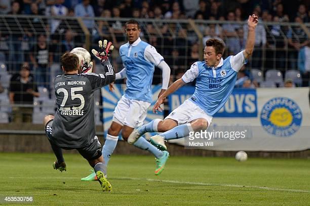 Peter Kurzweg of TSV 1860 Muenchen scores his team's first goal during the Regionalliga match between TSV 1860 Muenchen II and FC Bayern Muenchen II...