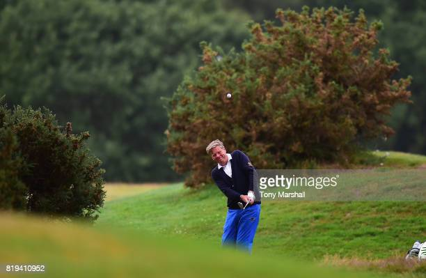 Peter Lane of Harpenden Golf Club plays his second shot on the 17th fairway during the PGA Lombard Trophy East Qualifier at Sandy Lodge Golf Club on...