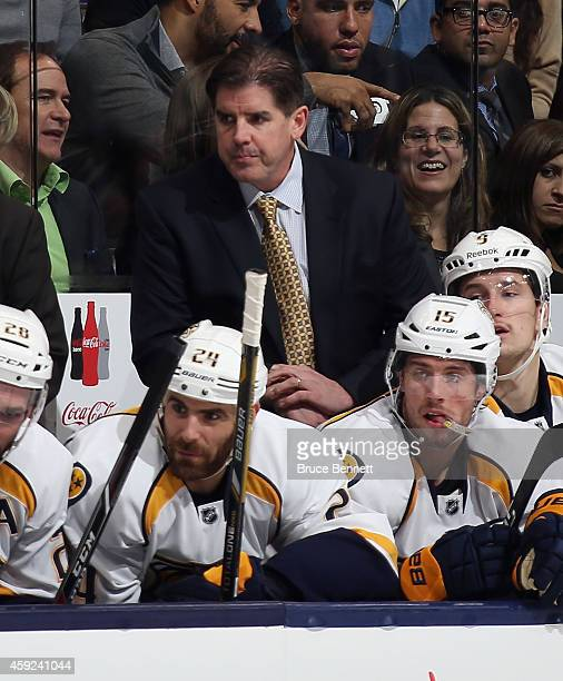 Peter Laviolette head coach of the Nashville Predators works the game against the Toronto Maple Leafs at the Air Canada Centre on November 18 2014 in...