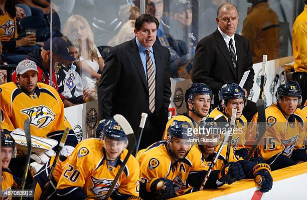 Peter Laviolette of the Nashville Predators coaches against the Dallas Stars at Bridgestone Arena on October 11 2014 in Nashville Tennessee