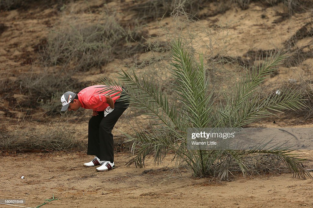 Peter Lawrie of Ireland looks at his lie on the eighth hole during the third round of the Omega Dubai Desert Classic at Emirates Golf Club on February 2, 2013 in Dubai, United Arab Emirates.