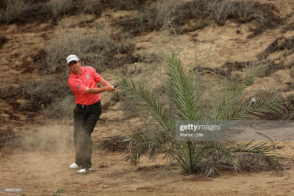 Peter Lawrie of Ireland plays his second shot on the eighth hole during the third round of the Omega Dubai Desert Classic at Emirates Golf Club on February 2, 2013 in Dubai, United Arab Emirates.