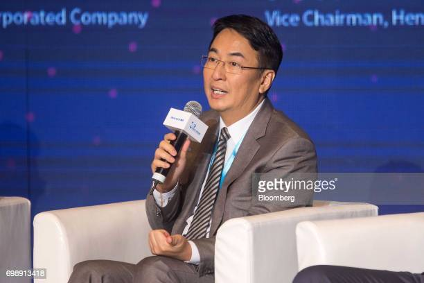 Peter Lee chairman of Henderson China Holdings Ltd speaks during the GuangdongHong KongMacao Greater Bay Area Forum in Hong Kong China on Tuesday...