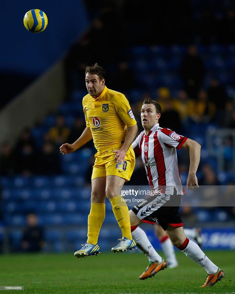 Peter Leven of Oxford United heads the ball during the FA Cup Third Round match between Oxford United and Sheffield United at the Kassam Stadium on January 5, 2013 in Oxford, England.