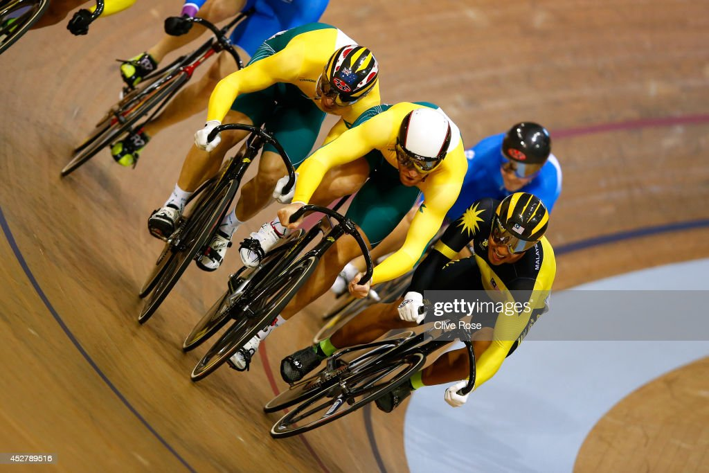 Peter Lewis of Australia and Mohd Azizulhasni Awang of Malaysia collide on the final bend during the Men's Keirin at the Sir Chris Hoy Velodrome during day four of the Glasgow 2014 Commonwealth Games on July 27, 2014 in Glasgow, United Kingdom.