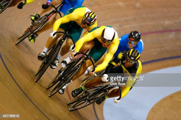 Peter Lewis of Australia and Mohd Azizulhasni Awang of Malaysia collide on the final bend during the Men's Keirin at the Sir Chris Hoy Velodrome...