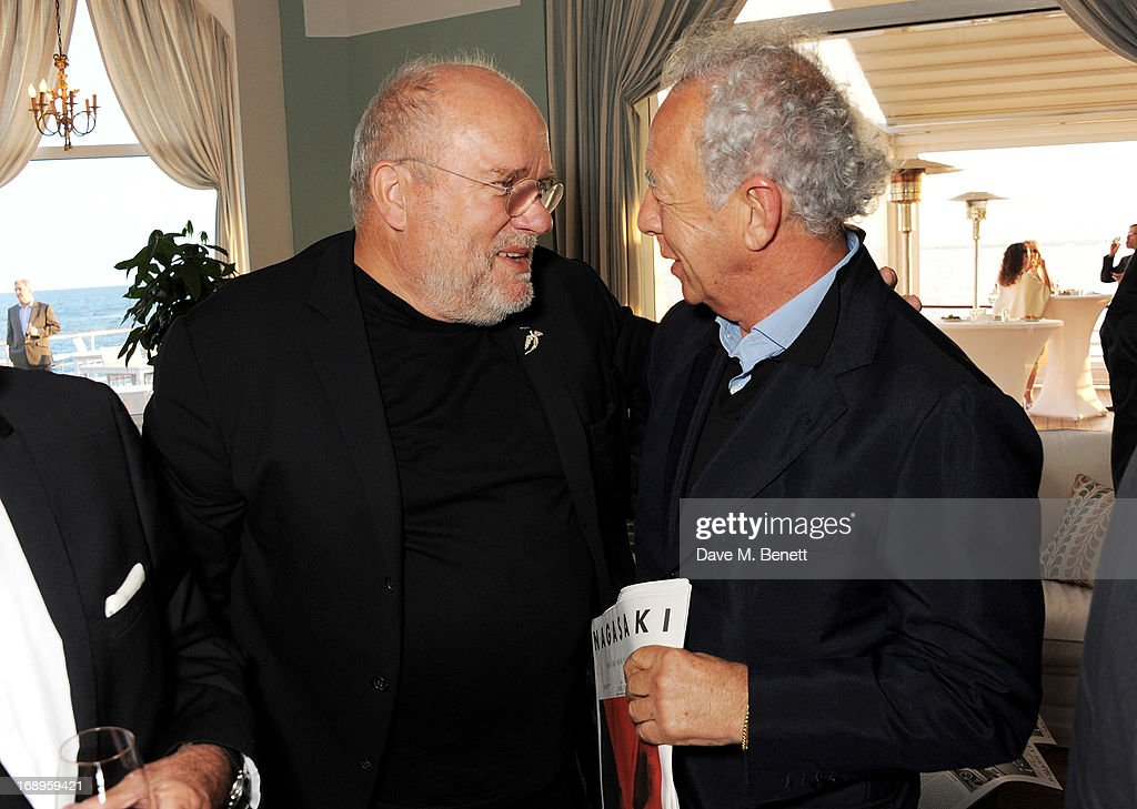 Peter Lindbergh (L) and Gilles Bensimon attend the annual Finch's Quarterly Review Filmmakers Dinner hosted by Charles Finch, Caroline Scheufele and Nick Foulkes at Hotel Du Cap Eden Roc on May 17, 2013 in Antibes, France.