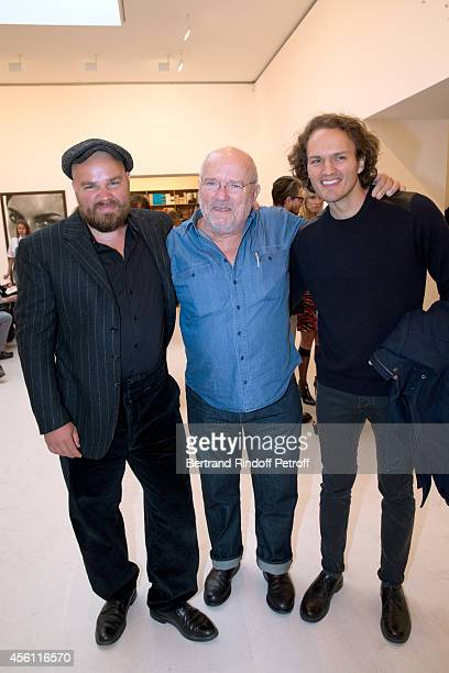 Peter Lindbergh standing between his sons Jeremy Lindbergh and Simon Lindbergh attend the 'Photographer Peter Lindbergh' Exhibition at Gagosian...