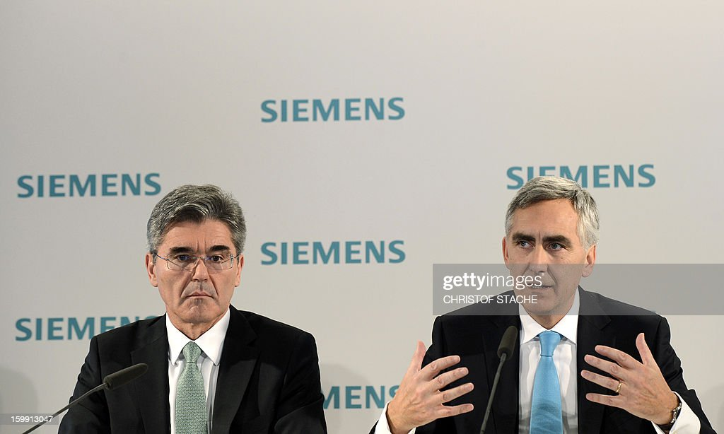 Peter Loescher, CEO of German industrial giant Siemens (R) and Joe Kaeser, member of the Managing Board and Head of Corporate Finance and Controlling (L) attend a press conference ahead of the company's shareholders meeting on January 23 , 2013 in Munich, southern Germany. Siemens said on January 23, 2013 that earnings and orders fell in the first quarter, but it was hoping a shake-up of its businesses would nevertheless enable it to meet its full-year targets.