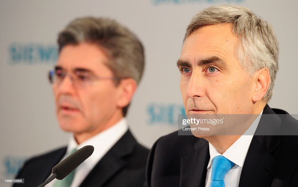 Peter Loescher (R), President and Chief Executive Officer of Siemens AG, and Joe Kaeser, Member of the Managing Board and Head of Corporate Finance and Controlling, speak to the media to announce financial results for the first quarter of 2013 prior to the Siemens annual general shareholders' meeting at the Olympiahalle on January 23, 2013 in Munich, Germany. Siemens announced that although the new orders declined slightly year-over-year, the book-to-bill ratio was again above 1 for the first time in three quarters. Total Sectors profit rose some four percent.